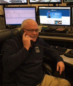 Van Houten answers a call in OUPD's communications center.